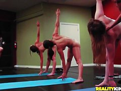 Group of girls perform yoga exercises naked